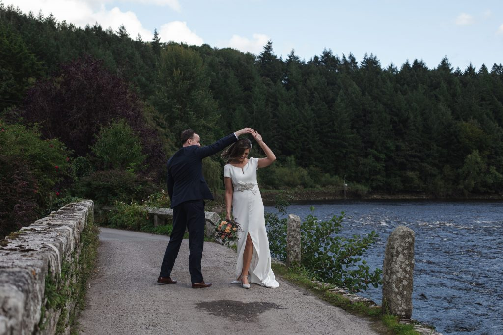 Gemma and Paddy New Ross wedding couple dancing together next to a river