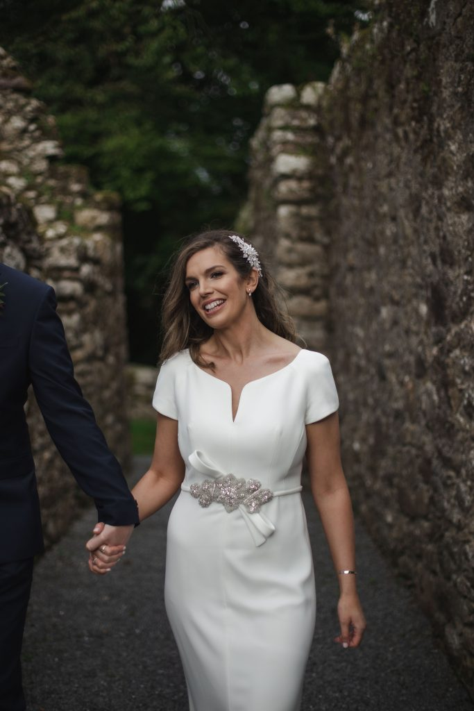 Gemma and Paddy New Ross wedding couple castle ruins smiling bride