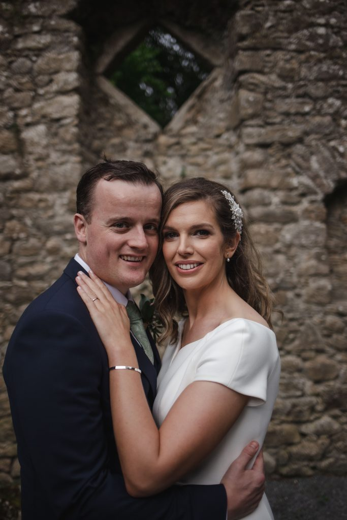 Gemma and Paddy New Ross wedding couple castle ruins couple looking at the camera