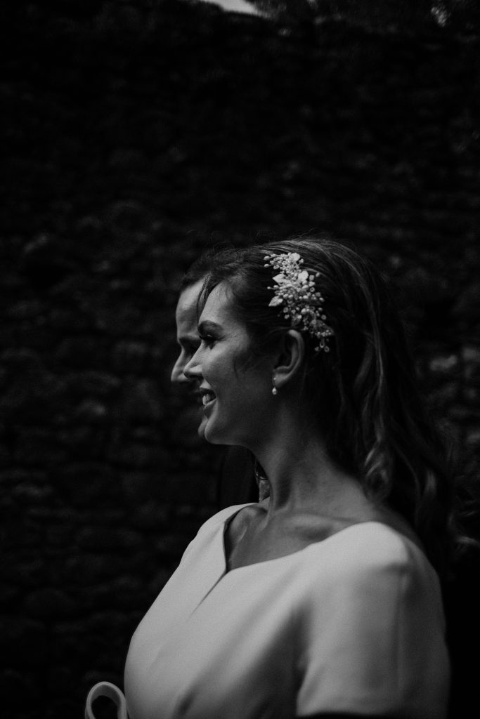 Gemma and Paddy New Ross wedding couple castle ruins couples profile angle