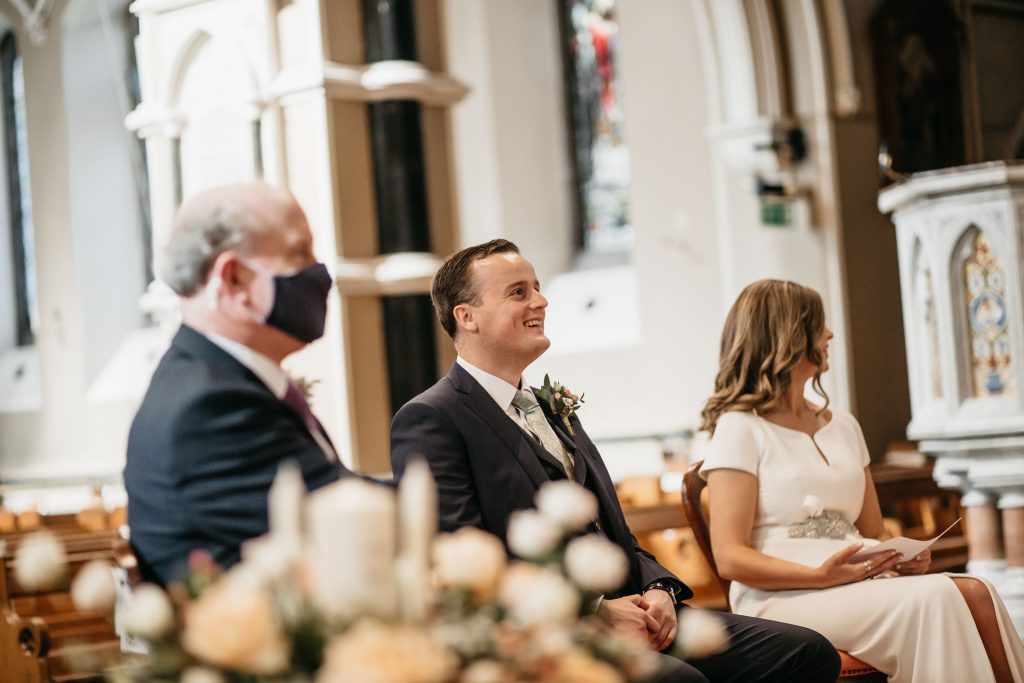 Gemma and Paddy New Ross Intimate wedding St. Mary and Michael Catholic Church groom laughing