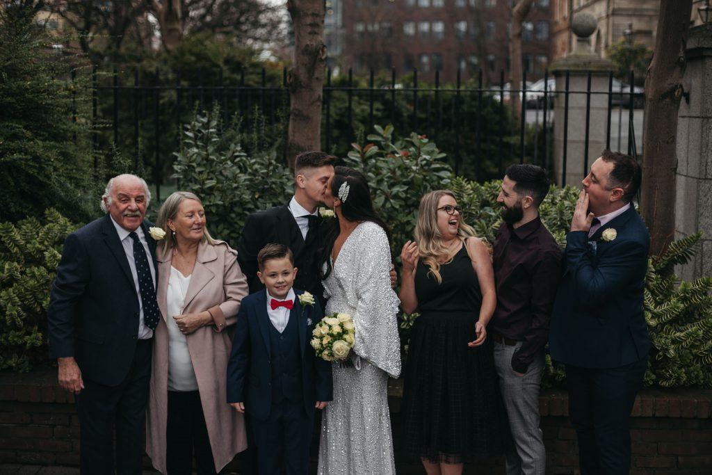 Troy and Laura Dublin City Wedding kissing family portrait