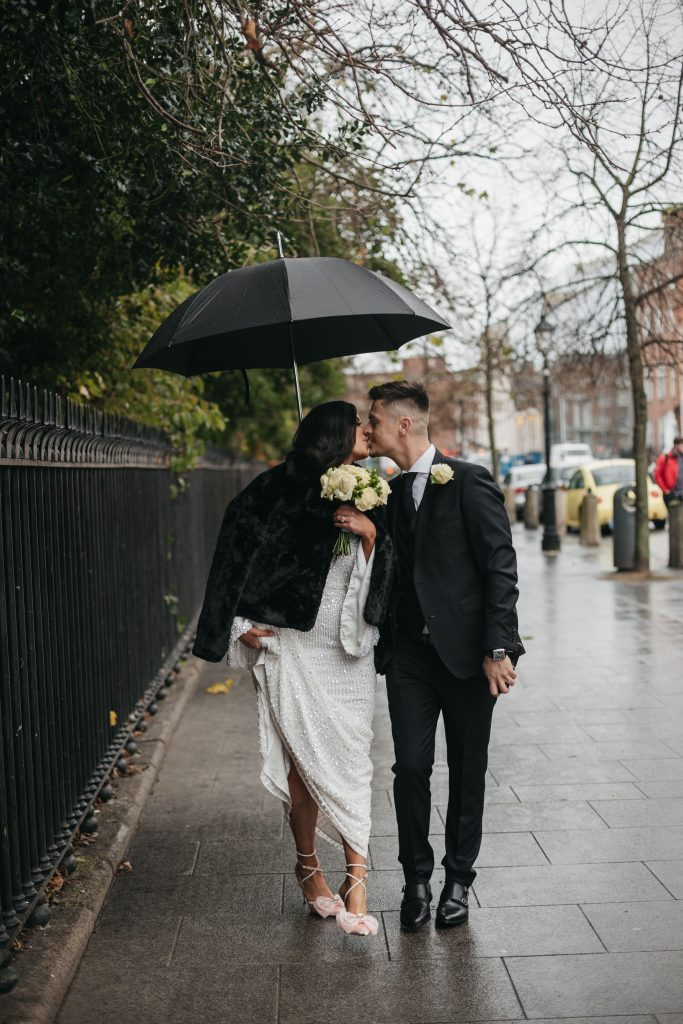 Troy and Laura Dublin City Wedding st stephens green couple walking and kissing