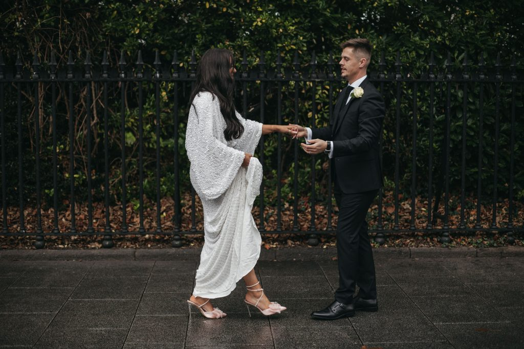 Troy and Laura Dublin City Wedding st stephens green couple dancing in the rain