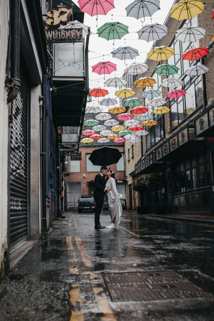Troy and Laura Dublin City intimate Wedding under the Dublin umbrellas