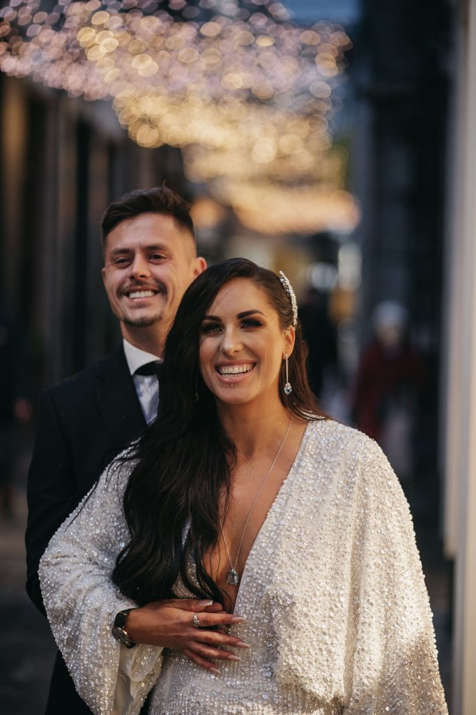 Troy and Laura Dublin City Wedding Grafton street christmas lights happy smiling couple
