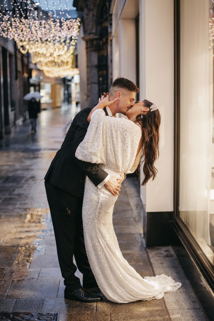 Troy and Laura Dublin City Wedding Grafton street kissing under the christmas lights
