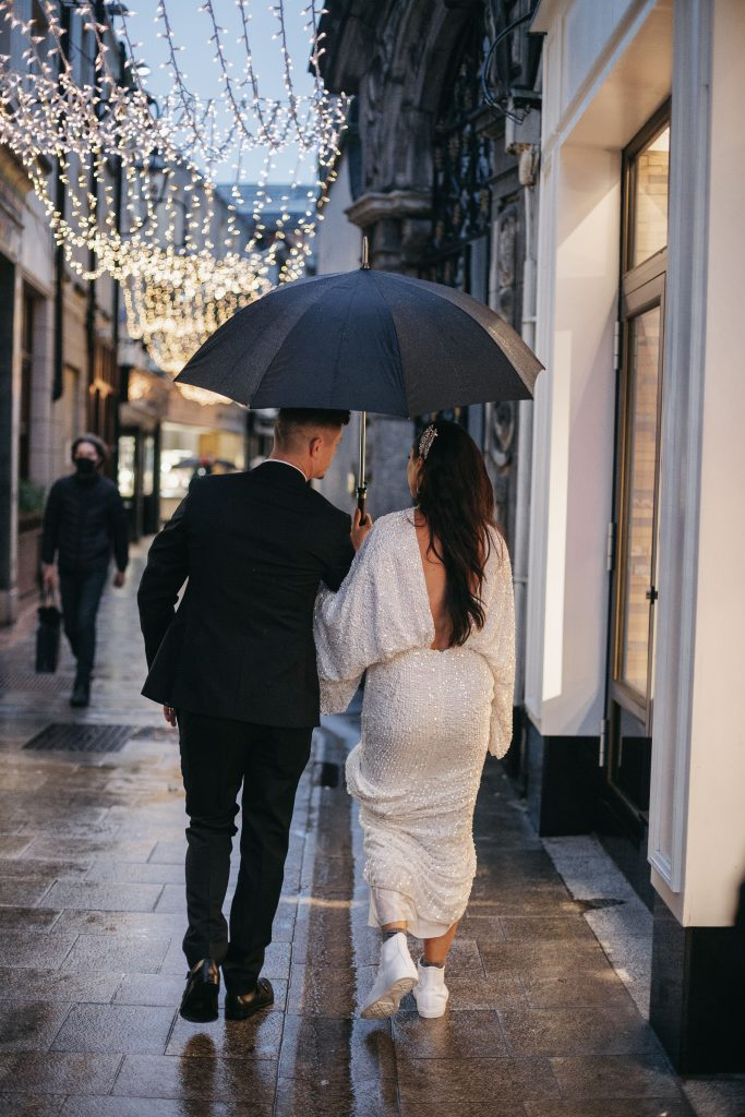 Troy and Laura Dublin City Wedding Grafton street walking under the fairy lights