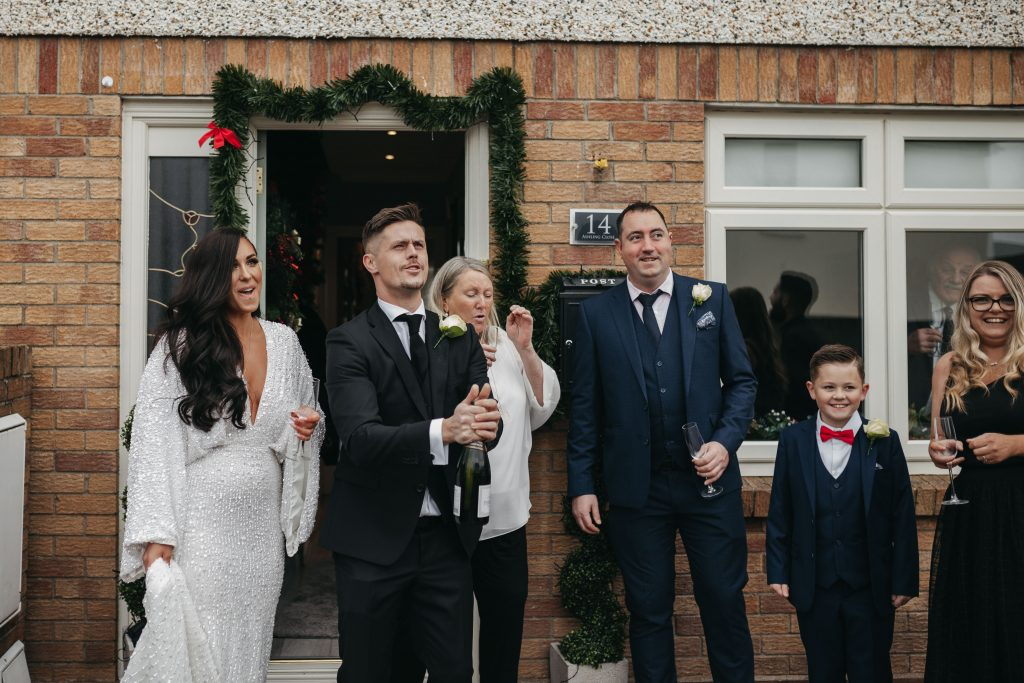 Troy and Laura Dublin City Wedding popping champagne